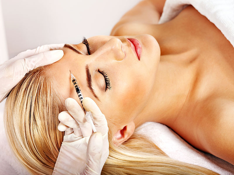 Women receiving botox treatment